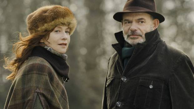 Isabelle Huppert and Jean-Paul Darroussin play husband and wife in Folies Bergere.