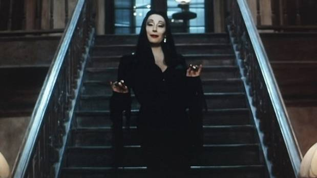 GHOULISHLY GOOD: As Morticia Addams.
