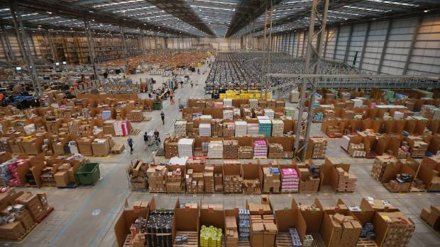 MODERN CHRISTMAS SHOPPING:  Employees select and dispatch items in the huge Amazon 'fulfilment centre' warehouse in ...