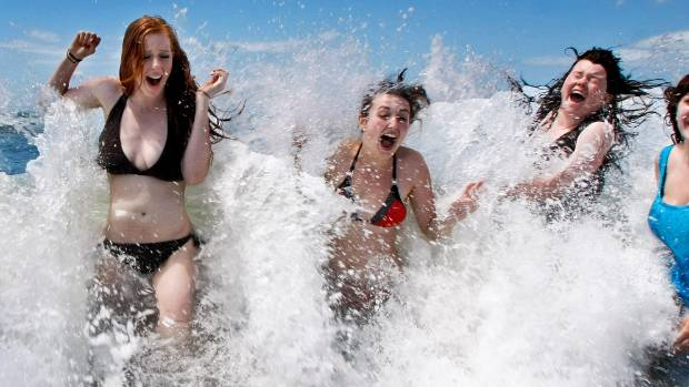 GIRLS IN THE SURF: Sumner on a hot day early in the summer.
