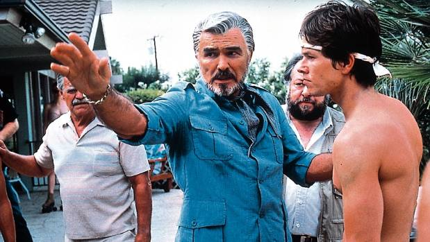 Burt Reynolds, left, and Mark Wahlberg in Boogie Nights.