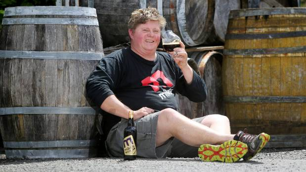 Taste test: Mike's Brewery owner Ron Trigg samples some of his famous whisky porter.