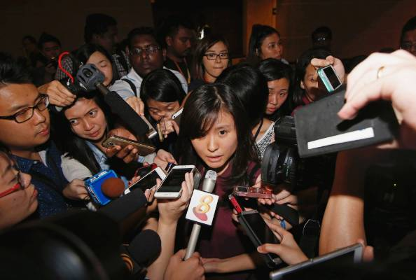 Louis Sidharta, a 25-year-old Indonesian whose fiance was onboard the AirAsia flight QZ8501, speaks to the media at a ...