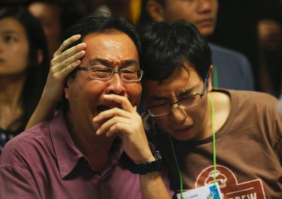 Relatives of passengers onboard AirAsia QZ8501 react to news that bodies and wreckage have been found.