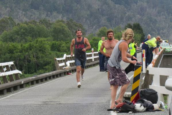 Jason McBride and Eco Rafting owner Josh Marcotte rush to search the Wanganui River, near Harihari, for signs of a car ...