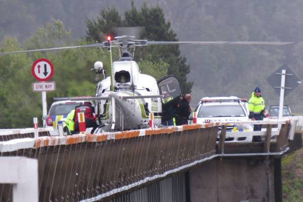 NZCC rescue helicopter from Greymouth lands on Wanganui Bridge after seemingly pulling an object from the river about ...