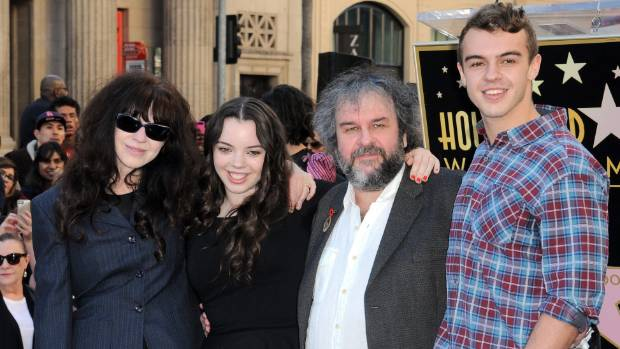 Fran Walsh and Peter Jackson, pictured with daughter Katie, have helped save St Christopher's Church and will lease it ...