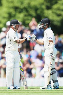Brendon McCullum, left, is congratulated by Kane Williamson after scoring 1000 test runs in 2014.