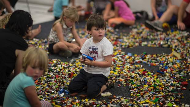 Small beginnings: Reuben Ashworth, 6, works on the foundations for his Lego house.