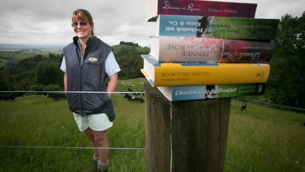 CHICKEN LIT: Danielle Hawkins displays her chick lit novels on her farm in Otorohanga.