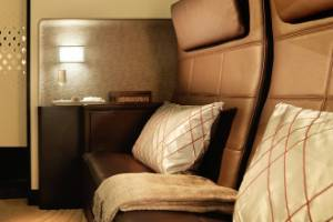 Etihad Residence - a private lavatory, a sitting area and a bed, a real bed, that accommodates two people.