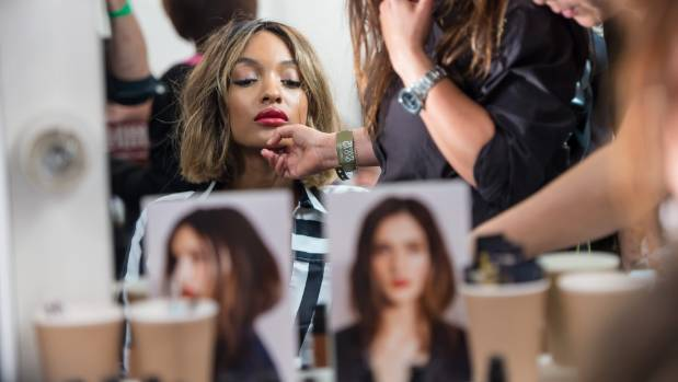 TOP MODEL: Jourdan Dunn, seen here preparing for the Burberry Prorsum catwalk show last year, is the first black woman ...