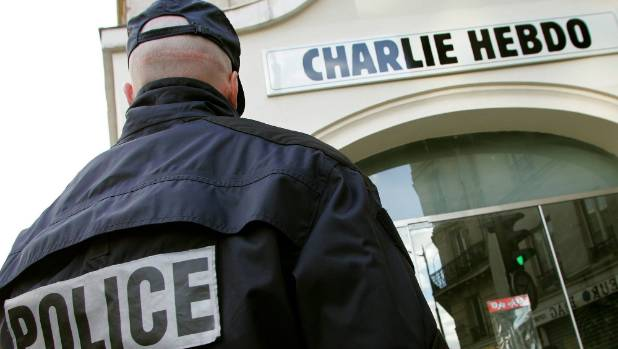PROVOCATIVE: A policeman stands guard outside the French satirical weekly Charlie Hebdo in Paris in this February 9, ...