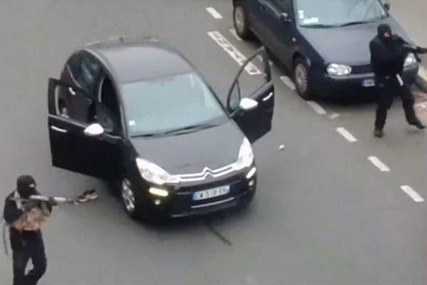 Gunmen shoot a police officer dead outside the offices of French satirical newspaper Charlie Hebdo in Paris, in this ...