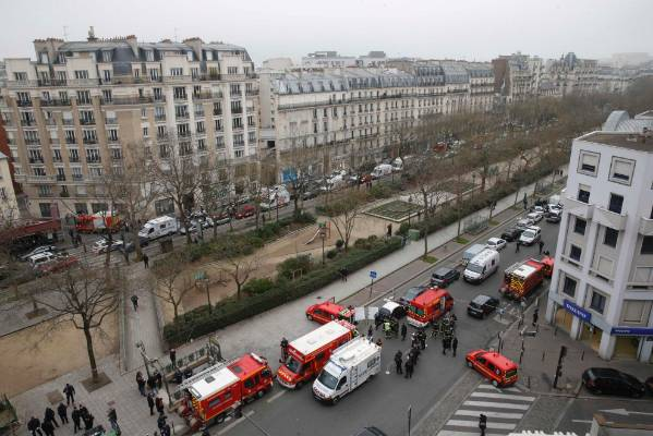 Police and emergency services are seen near the scene of the Paris terror attack.