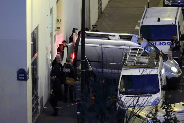 French policemen stand next to funeral hearse in front of the entrance of the Paris offices of Charlie Hebdo after the ...