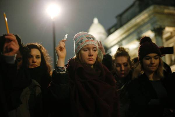 Vigils were held all over Europe for the victim, this one in London where people raised pens to honour the journalists.