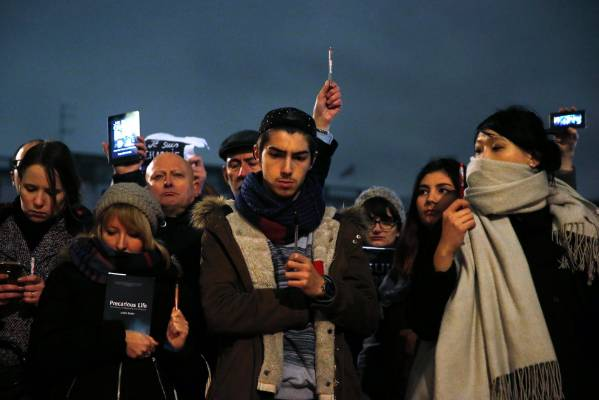LONDON: People raise pens and signs at a vigil in Trafalgar Square.
