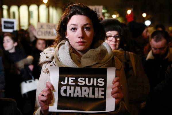 """A woman holds a placard that reads, """"I am Charlie"""", during a vigil at Trafalgar Square in London."""