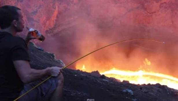 AHH, THAT'S TOASTY: Christchurch man Simon Turner relaxes with a brew and toasts a marshmallow over a volcano.