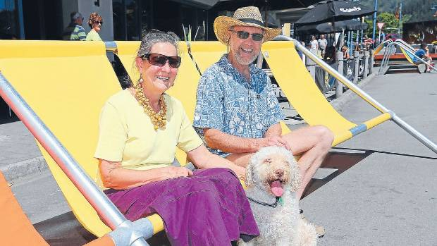 Picton couple Ian and Paula Allen, with their dog Azar, think the sunloungers on Picton's waterfront are a great idea ...