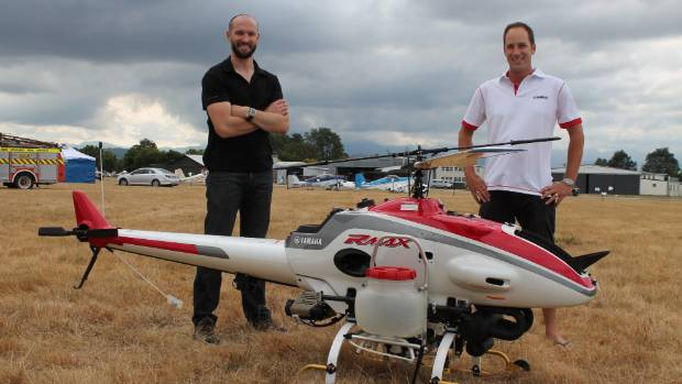 FUTURE OF AVIATION: Callaghan Innovation's Chris Thomson and Yamaha's Geoff Lamb set up Yamaha's drone for New Zealand's ...