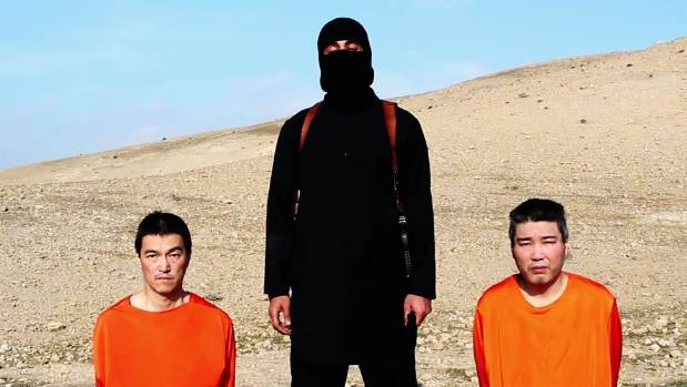 DOCTORED VIDEO? An IS militant with the two Japanese hostages, journalist Kenji Goto Jogo, left, and military contractor ...