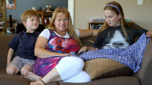 BIG BILLS: Tracy Unger with son, Christian, 7, and daughter Emily, 10.