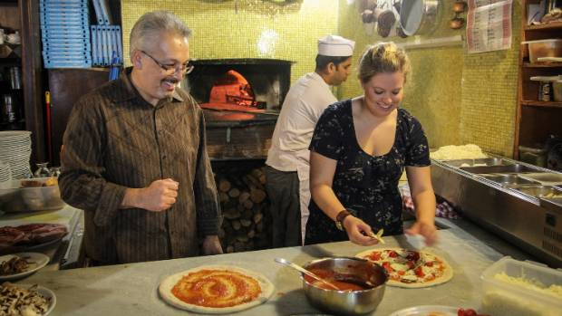 WHEN IN ROME: Learning to make pizza.
