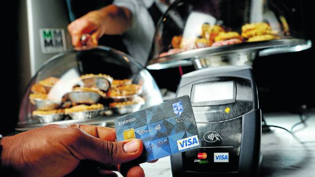 New contactless payment systems are driving more transactions through the credit card network, say retailers.