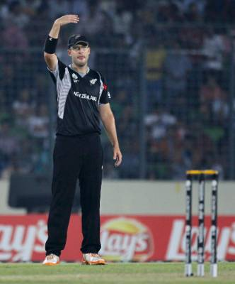 New Zealand's captain Daniel Vettori adjusts his fielding positions during the Black Caps' Cricket World Cup ...
