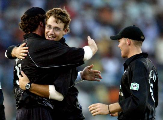 New Zealand spin bowler Daniel Vettori hugs teammate Kyle Mills who took the catch off Indian batsman Yuvraj Singh as ...