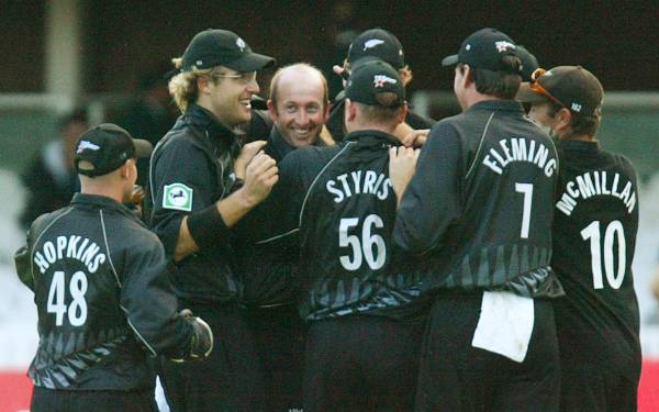 Daniel Vettori, left, celebrates with his teammates after Chris Harris claimed his 200th ODI wicket during his side's ...