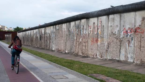 A cyclist passes the Berlin Wall memorial at Bernauerstrasse, Berlin.