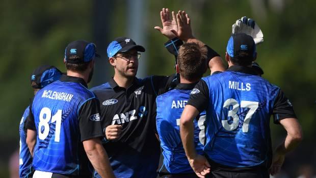HIGH FIVE: Black Caps veteran Daniel Vettori celebrates a wicket with his team-mates in Dunedin.