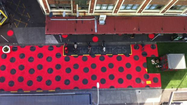 Not everyone is happy Bond St in Wellington has gone dotty for summer, with decorations, a swing, and live jazz.