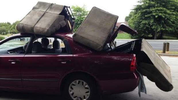 A Hamilton man was stopped with three sofa chairs tied onto his car with string.