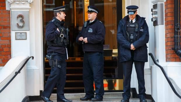 Metropolitan Police officers stand guard outside the Ecuadorian embassy in London, where Julian Assange is holed up.
