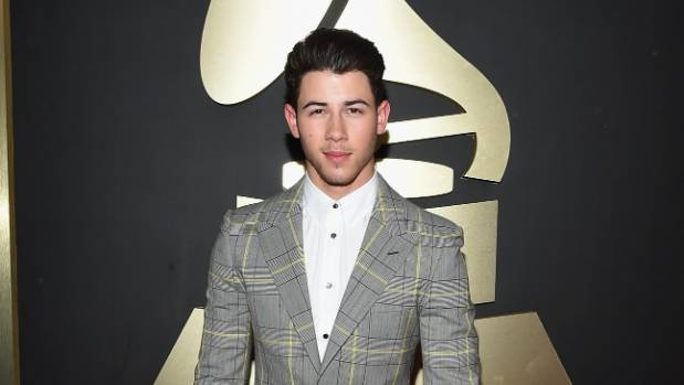 Nick Jonas attends The 57th Annual GRAMMY Awards.