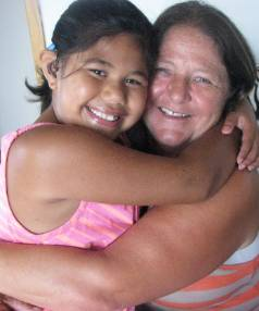PRECIOUS MOMENT: Grandmother Jody Malam with granddaughter Keshia Uele, 7, who was born profoundly deaf. Keshia received ...