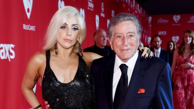 Singers Lady Gaga (L) and Tony Bennett attend the 25th anniversary MusiCares 2015 Person Of The Year Gala honoring Bob ...