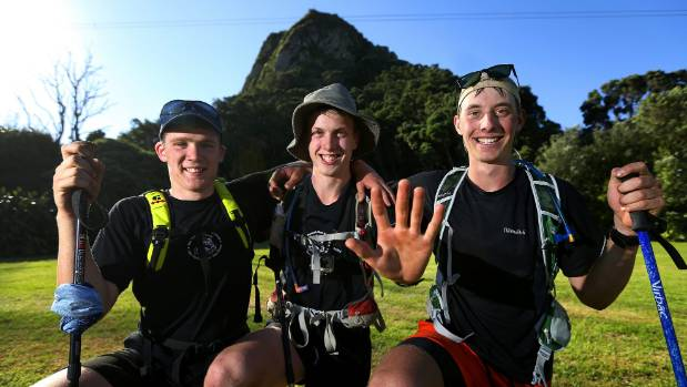 Hamish Sturmer, left, Thomas Spencer and William Adlam climbed five peaks one one day.