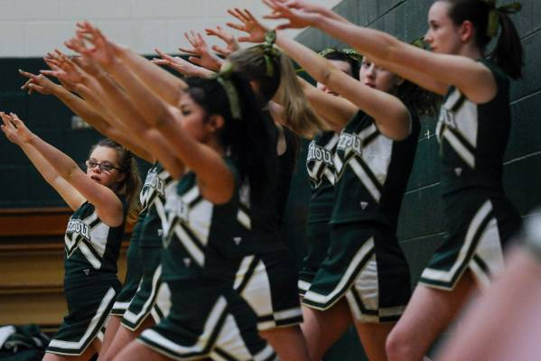 Manitou Springs sophomore Kory Mitchell, left, who was born with Down syndrome, cheers during a free-throw at a ...