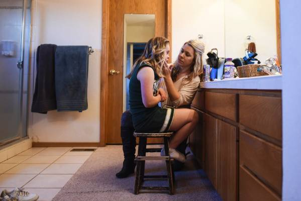 Bonnie King, right, helps her daughter and Manitou Springs varsity cheerleader Kory Mitchell, 16, put on her makeup ...