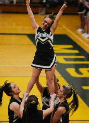Manitou Springs sophomore Kory Mitchell, who was born with Down syndrome, flies and cheers during a break between ...