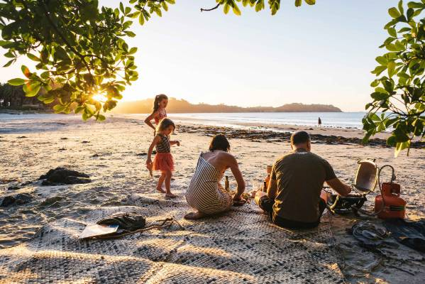 ISLAND LIFE: The family, together with Ana's mother Molly, loves to barbecue at Onetangi Beach just down the road.