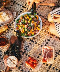 Spread out on hand-woven mats from Fiji, the picnic includes a favourite salad of peaches, prosciutto, rocket and soft ...