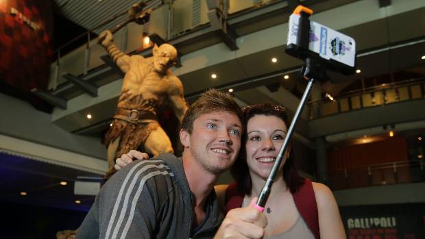 EVERYONE IN: English tourists Matthew Shufflebottom and Lucy Brown, turned to their selfie stick in order to get a good ...