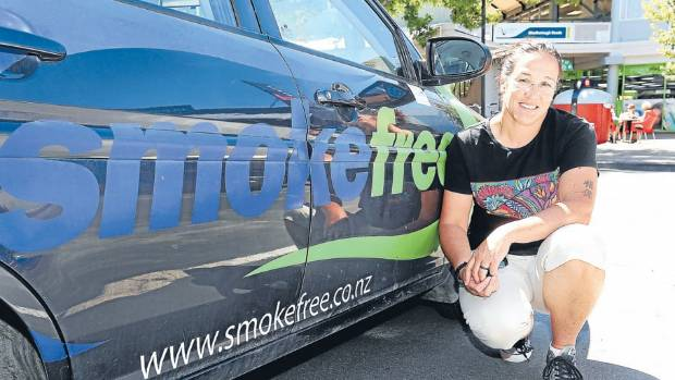 Smoking cessation support worker Cynthia de Joux pictured with her sign-written car.