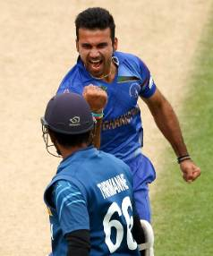 MIGHTY MINNOWS: Dawlat Zadran of Afghanistan celebrates the wicket of Sri Lanka's Lahiru Thirimanne during Sunday's ...